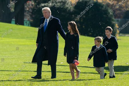 US President Donald J. Trump returns to the White House with grandchildren Arabella, Theodore, and Joseph Kushner after spending Thanksgiving weekend at Camp David, in Washington, DC, USA, 29 November 2020.