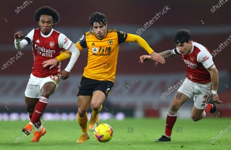 Stock Image of Wolverhampton Wanderers' Pedro Neto, centre, competes for the ball with Arsenal's Willian, left, and Calum Chambers, right, during the English Premier League soccer match between Arsenal and Wolverhampton Wanderers at Emirates Stadium, London