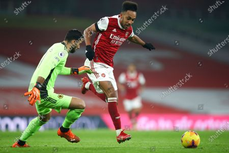 Stock Picture of Arsenal's Pierre-Emerick Aubameyang, right, attempts to take the ball past Wolverhampton Wanderers' goalkeeper Rui Patricio during the English Premier League soccer match between Arsenal and Wolverhampton Wanderers at Emirates Stadium, London