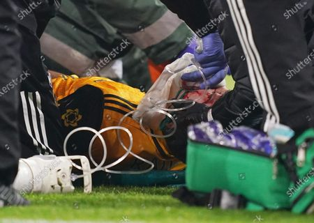 Raul Jimenez of Wolverhampton receives medical treatment during the English Premier League soccer match between Arsenal FC and Wolverhampton Wanderers in London, Britain, 29 November 2020.