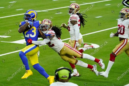 Stock Picture of Los Angeles Rams running back Cam Akers (23) is tackled by San Francisco 49ers cornerback Jason Verrett during the second half of an NFL football game, in Inglewood, Calif