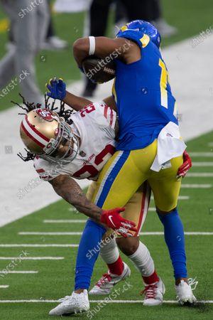 San Francisco 49ers cornerback Jason Verrett (22), left, tackles Los Angeles Rams wide receiver Robert Woods (17) during an NFL football game, in Inglewood, Calif