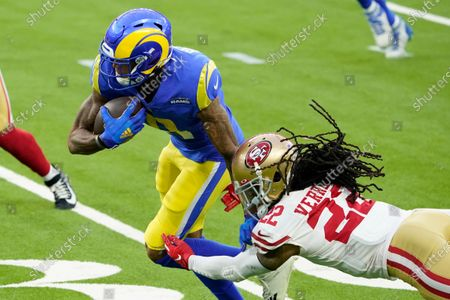 Stock Photo of San Francisco 49ers cornerback Jason Verrett (22) hits Los Angeles Rams wide receiver Josh Reynolds (11) during the second half of an NFL football game, in Inglewood, Calif
