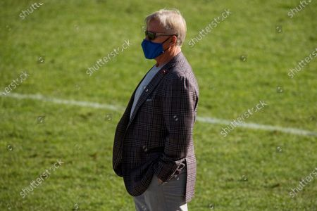 General manager and President of Football Operations of the Denver Broncos John Elway stands on the field before an NFL football game against the New Orleans Saints, in Denver