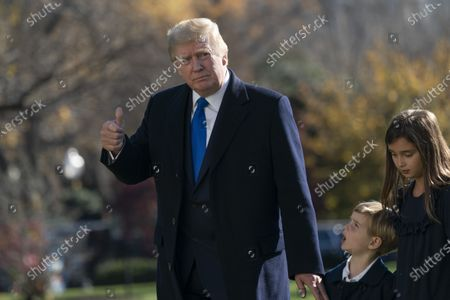United States President Donald J. Trump returns to the White House in Washington, DC with his grandchildren, Theodore and Arabella Kushner after spending Thanksgiving weekend at Camp David, the presidential retreat near Thurmont, Maryland