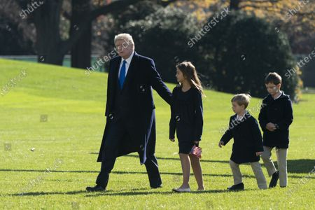 United States President Donald J. Trump returns to the White House in Washington, DC with his grandchildren, Theodore, Joseph and Arabella Kushner after spending Thanksgiving weekend at Camp David, the presidential retreat near Thurmont, Maryland