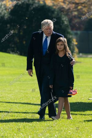 United States President Donald J. Trump returns to the White House in Washington, DC with his granddaughter Arabella Kushner after spending Thanksgiving weekend at Camp David, the presidential retreat near Thurmont, Maryland