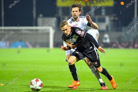 Mattia Bottani (#10 FC Lugano) and Valentin Stocker (#14 FC Basel 1893) in action during the Swiss Super League match between FC Lugano and FC Basel 1893