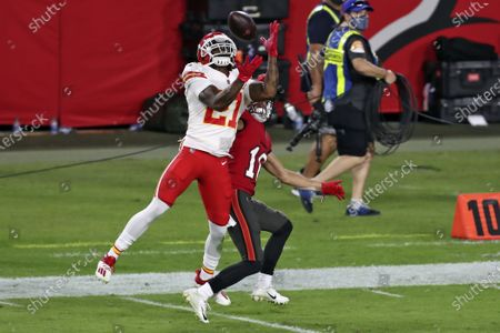 Stock Picture of Kansas City Chiefs cornerback Rashad Fenton (27) intercepts a pass intended for Tampa Bay Buccaneers wide receiver Scott Miller (10) during the second half of an NFL football game, in Tampa, Fla