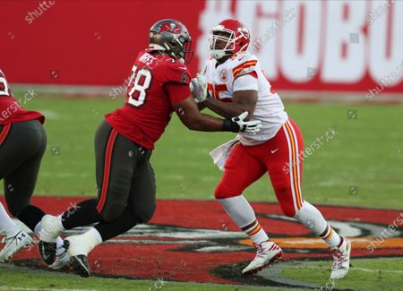 Kansas City Chiefs defensive tackle Chris Jones (95) works against Tampa Bay Buccaneers offensive tackle Tristan Wirfs (78) during the first half of an NFL football game, in Tampa, Fla