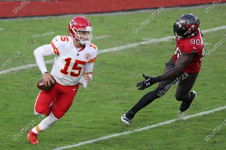 Kansas City Chiefs quarterback Patrick Mahomes (15) eludes Tampa Bay Buccaneers outside linebacker Jason Pierre-Paul (90) during the first half of an NFL football game, in Tampa, Fla