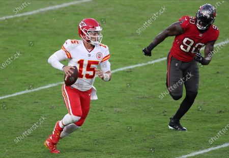 Tampa Bay Buccaneers outside linebacker Jason Pierre-Paul (90) chases Kansas City Chiefs quarterback Patrick Mahomes (15) during the first half of an NFL football game, in Tampa, Fla
