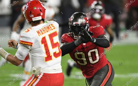 Stock Image of Tampa Bay Buccaneers outside linebacker Jason Pierre-Paul (90) pressures Kansas City Chiefs quarterback Patrick Mahomes (15) during the second half of an NFL football game, in Tampa, Fla