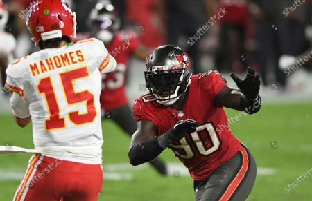 Stock Photo of Tampa Bay Buccaneers outside linebacker Jason Pierre-Paul (90) prressures Kansas City Chiefs quarterback Patrick Mahomes during the second half of an NFL football game, in Tampa, Fla