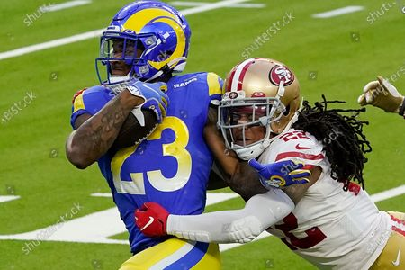 Stock Photo of Los Angeles Rams running back Cam Akers (23) is tackled by San Francisco 49ers cornerback Jason Verrett (22) during the second half of an NFL football game, in Inglewood, Calif