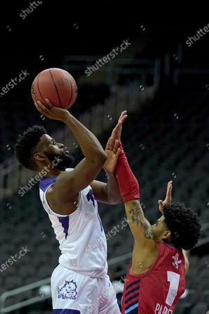 TCU's Mike Miles, left, shoots over Liberty's Chris Parker (1) during the second half of an NCAA college basketball game, at the T-Mobile Center in Kansas City, Mo. TCU won 56-52