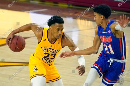 Arizona State forward Marcus Bagley (23) drives against Houston Baptist guard Pedro Castro during the first half of an NCAA college basketball game, in Tempe, Ariz