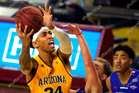 Arizona State forward Jalen Graham (24) shoots over Houston Baptist guard Ty Dalton, center, and Pedro Castro during the first half of an NCAA college basketball game, in Tempe, Ariz