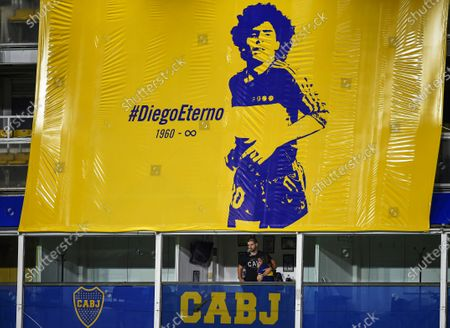 Dalma Maradona, right, daughter of Diego Maradona, stands in her father's box during a local tournament match between Boca Juniors and Newell's Old Boys at the Alberto J. Armando Stadium in Buenos Aires, Argentina, . The Argentine soccer great died from a heart attack at his home Wednesday, Nov. 25, at the age of 60