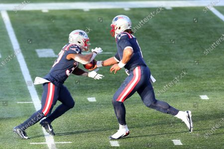 Foxborough, MA, USA; New England Patriots quarterback Cam Newton (1) hands off to New England Patriots running back Damien Harris (37) during the NFL game between Arizona Cardinals and New England Patriots at Gillette Stadium
