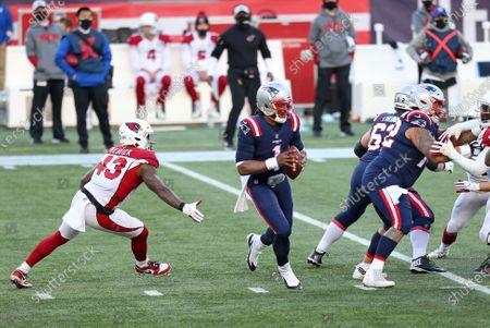 Foxborough, MA, USA; New England Patriots quarterback Cam Newton (1) avoids a tackle by Arizona Cardinals outside linebacker Haason Reddick (43) during the NFL game between Arizona Cardinals and New England Patriots at Gillette Stadium