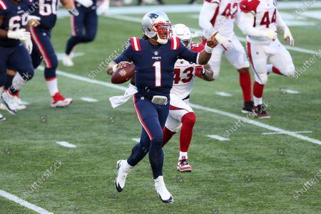 Foxborough, MA, USA; New England Patriots quarterback Cam Newton (1) scrambles during the NFL game between Arizona Cardinals and New England Patriots at Gillette Stadium