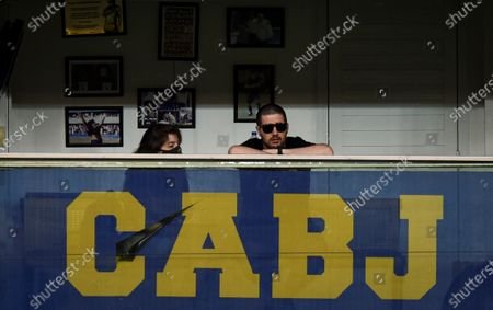 Dalma Maradona (L), daughter of Diego Maradona watches the game in her father's box during a match between Boca Juniors and Newell's Old Boys for the 2020 Argentine Primera Division, at La Bombonera stadium, in Buenos Aires, 29 November 2020. The Argentine football championship has been renamed to honour the late Diego Maradona.