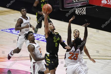 Stock Picture of South Florida's David Collins goes to the basket as Virginia Tech's Jalen Cone, left, and Virginia Tech's Tyrece Radford, right, defend in the first half of an NCAA college basketball game, in Uncasville, Conn