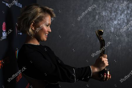 Stock Photo of Eliza Scanlen poses with the award for Best Lead Actress at the 2020 Australian Academy of Cinema and Television Arts (AACTA) Awards in Sydney, Australia, 30 November 2020.