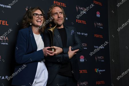 Stock Image of Australian writer Robyn Butler (L) and actor Wayne Hope pose with the award for Best Online Drama or Comedy at the 2020 Australian Academy of Cinema and Television Arts (AACTA) Awards in Sydney, Australia, 30 November 2020.