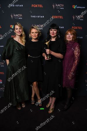 Stock Photo of Shannon Murphy, actress Eliza Scanlen and producers Alex White and Jan Chapman pose with the award for Best Film at the 2020 Australian Academy of Cinema and Television Arts (AACTA) Awards in Sydney, Australia, 30 November 2020.