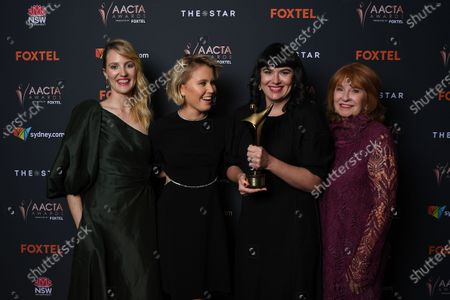 Shannon Murphy, actress Eliza Scanlen and producers Alex White and Jan Chapman pose with the award for Best Film at the 2020 Australian Academy of Cinema and Television Arts (AACTA) Awards in Sydney, Australia, 30 November 2020.
