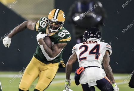 Green Bay Packers tight end Marcedes Lewis (L) runs against Chicago Bears cornerback Buster Skrine (R) during the NFL American Football game between the Chicago Bears and the Green Bay Packers at Lambeau Field in Green Bay, Wisconsin, USA, 29 November 2020.