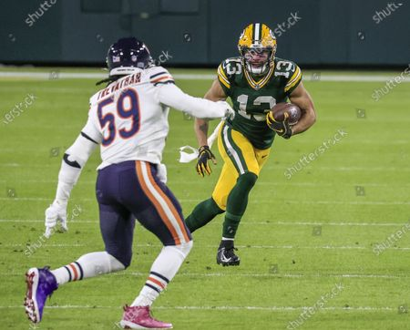 Green Bay Packers wide receiver Allen Lazard (R) runs with the ball on Chicago Bears inside linebacker Danny Trevathan (L) during the NFL American Football game between the Chicago Bears and the Green Bay Packers at Lambeau Field in Green Bay, Wisconsin, USA, 29 November 2020.