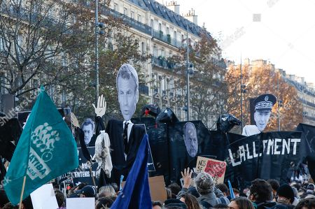 Demonstrators hold effigies of French Interior Minister Gerard Darmanin, French President Emmanuel Macron, French Justice Minister Eric Dupont-Moretti and Paris police prefect Didier Lallement durind a protest against the newly passed controversial global security law, in Paris, France, 28 November 2020. The global security legislation passed by the French Parliament aims to ban the distribution of photos in which police officers and gendarmes can be identified in a way which is harmful to their image.