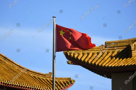 A Chinese national flag flies at the Chinese Embassy in in Canberra, Australia, 30 November 2020. On 30 November, Australian Prime Minister Scott Morrison call for China to apologise for a social media post depicted an Australian soldier murdering an Afghan child. According to the Australian government, China's Foreign Ministry spokesman Lijian Zhao posted the image.