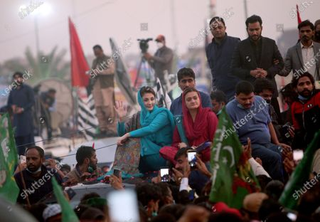 Stock Photo of Maryam Nawaz Sharif, center, in blue dress, a leader of the Pakistan Democratic Movement, an alliance of opposition parties, waves to her supporter during an anti-government rally, in Multan, Pakistan, . Despite a government ban and arrests of hundreds of activists, Pakistani opposition supporters rallied in a central city on Monday, calling on Prime Minister Imran Khan to resign over alleged bad governance and incompetence