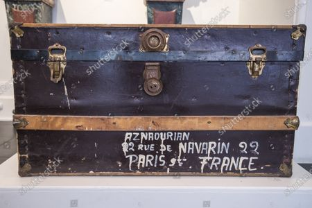 A travel trunk belonging to Charles Aznavour's family, is displayed as part of the sale by the Piasa auction house of the collections of the musician Georges Garvarentz, in Paris, France, 30 November 2020. Garvarentz (1932-1993), a famous songwriter and film music composer, was married to the sister of late French singer Charles Aznavour. The auction is taking place online on 04 December 2020.