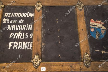 Stock Picture of A travel trunk belonging to Charles Aznavour's family, is displayed as part of the sale by the Piasa auction house of the collections of the musician Georges Garvarentz, in Paris, France, 30 November 2020. Garvarentz (1932-1993), a famous songwriter and film music composer, was married to the sister of late French singer Charles Aznavour. The auction is taking place online on 04 December 2020.