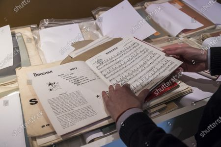 Stock Photo of The auctioneer shows music sheets belonging to Georges Garaventz, as part of the sale by the Piasa auction house of the collections of the musician Georges Garvarentz, in Paris, France, 30 November 2020. Garvarentz (1932-1993), a famous songwriter and film music composer, was married to the sister of late French singer Charles Aznavour. The auction is taking place online on 04 December 2020.