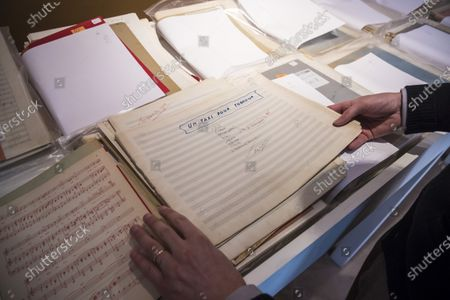 The auctioneer shows music sheets belonging to Georges Garaventz, as part of the sale by the Piasa auction house of the collections of the musician Georges Garvarentz, in Paris, France, 30 November 2020. Garvarentz (1932-1993), a famous songwriter and film music composer, was married to the sister of late French singer Charles Aznavour. The auction is taking place online on 04 December 2020.