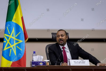"""Ethiopia's Prime Minister Abiy Ahmed responds to questions from members of parliament at the prime minister's office in the capital Addis Ababa, Ethiopia . The fugitive leader of Ethiopia's defiant Tigray region on Monday called on Prime Minister Abiy Ahmed to withdraw troops from the region as he asserted that fighting continues """"on every front"""" two days after Abiy declared victory"""