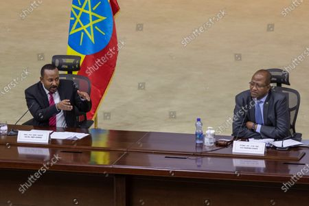 """Ethiopia's Prime Minister Abiy Ahmed, left, responds to questions from members of parliament, accompanied by Speaker of the Ethiopian House of Peoples Representatives Tagesse Chafo, right, at the prime minister's office in the capital Addis Ababa, Ethiopia . The fugitive leader of Ethiopia's defiant Tigray region on Monday called on Prime Minister Abiy Ahmed to withdraw troops from the region as he asserted that fighting continues """"on every front"""" two days after Abiy declared victory"""