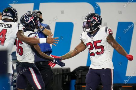 Stock Photo of Houston Texans running back Duke Johnson (25) celebrates his touchdown against the Detroit Lions during the first half of an NFL football game, in Detroit