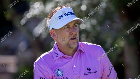 Stock Photo of Ian Poulter, of England, watches his drive down the 10th fairway during third round of the RSM Classic golf tournament, in St. Simons Island, Ga