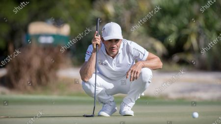 Camilo Villegas, of Colombia, lines up his putt on the ninth green during third round of the RSM Classic golf tournament, in St. Simons Island, Ga