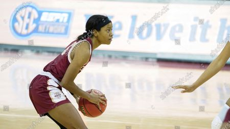 Charleston guard Taylor Williams surveys the defense during the second half of an NCAA college basketball game against South Carolina, in Columbia, S.C. South Carolina won 119-38
