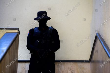 A policeman watches over the access to the detention area of the Palace of Justice where two brothers of former Dominican President Danilo Medina (2012-2020) are detained, in Santo Domingo, Dominican Republic, 30 November 2020. Medina's brothers were arrested yesterday morning as part of a group of former officials, suppliers and front men who allegedly took advantage of links with political power to accumulate fortunes during the past government period.