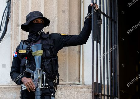 A policeman watches over the access to the Palace of Justice, where two brothers of former Dominican President Danilo Medina (2012-2020) are detained, in Santo Domingo, Dominican Republic, 30 November 2020.  Medina's brothers were arrested yesterday morning as part of a group of former officials, suppliers and front men who allegedly took advantage of links with political power to accumulate fortunes during the past government period.