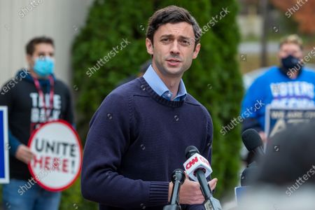 Democratic Georgia US Senate candidate Jon Ossoff speaks at a press conference about his opponent, Republican Senator David Perdue, in Atlanta, Georgia, USA, 30 November 2020. Ossoff is in a 05 January 2021 runoff election against Perdue. Ossoff commented on published reports of Senator Perdue's self-directed stock trading.